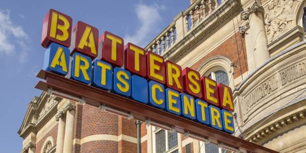 The sign outside our building - yellow letters spell out 'Battersea Arts Centre' on red and blue blocks