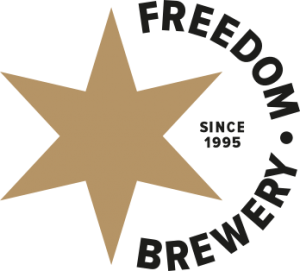 A gold star with Freedom Brewery text in a crescent surrounding it.