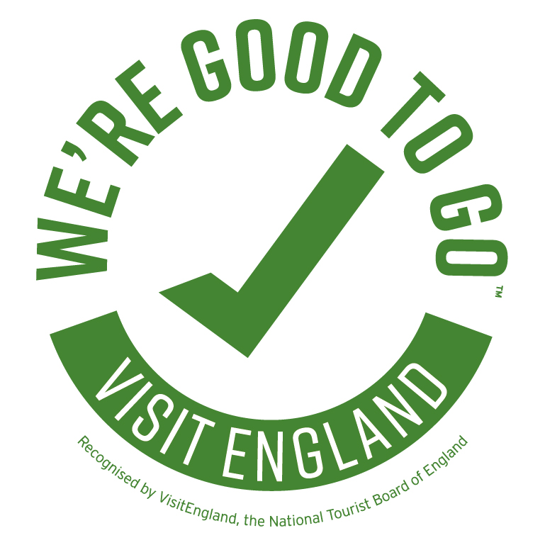 A green logo with text 'We're Good To Go Visit England' circling a large green tick.